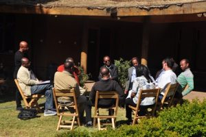 Stakeholder workshop participants sit outside and discuss ideas to build urban resilience in Addis Ababa