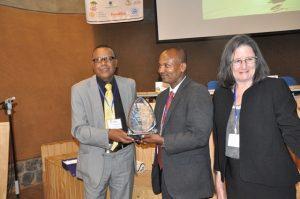 Prof. Negussie Retta handing over ALD trophy to H.E Dr. Gemedo Dale